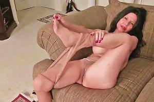 Busty MILF April White Peels Off Her Soaked Panties